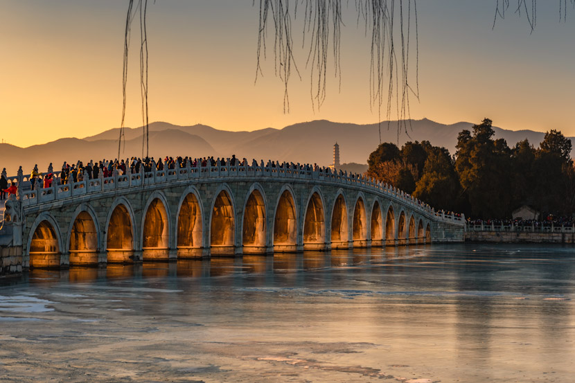 A view of Seventeen-Arch Bridge in the Summer Palace, Beijing, Dec. 20, 2020. The bridge is designed so that sunlight penetrates the arches during the Winter Solstice. People Visual