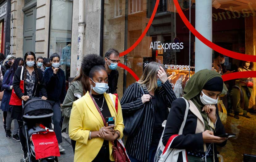 "People line up in front of the AliExpress pop-up store in Paris, France, Sept. 24, 2020. The store aims to showcase its fashion and decoration products, as well as its concept of ""shoppertainment"" in video streams. Geoffroy Van Der Hasselt/People Visual"