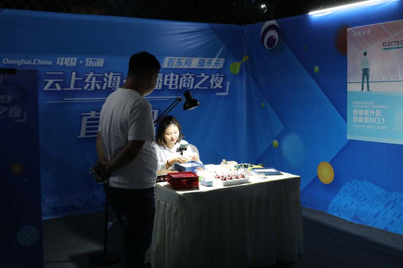 A livestreamer sells crystals during a commercial livestreaming event in Donghai County, Jiangsu province, Sept. 28, 2020. People Visual