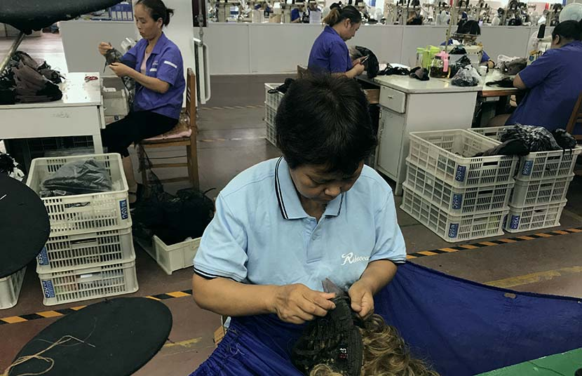 Workers make wigs at a factory in Xuchang, Henan province, July 3, 2018. People Visual