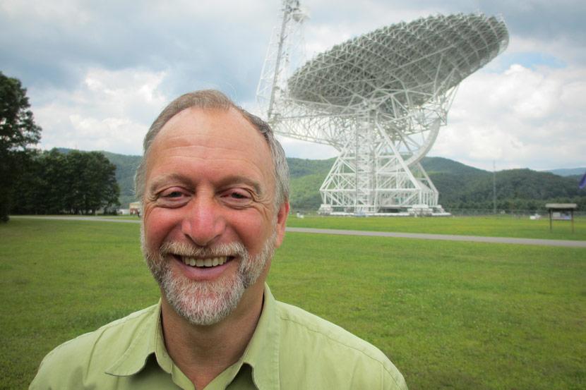 Professor Dan Werthimer of University of California, Berkeley, poses for a photo in front of the Green Bank Telescope in West Virginia, 2012. Courtesy of Dan Werthimer.