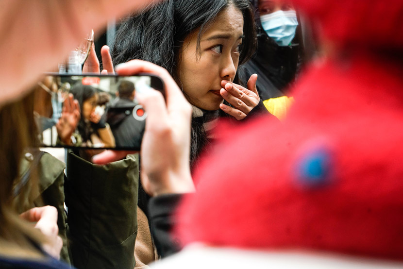Xianzi, the pseudonym used by the alleged victim, arrives at the courthouse for her sexual harassment lawsuit against TV host Zhu Jun, in Beijing, Dec. 2, 2020. Shirly Cai for Sixth Tone