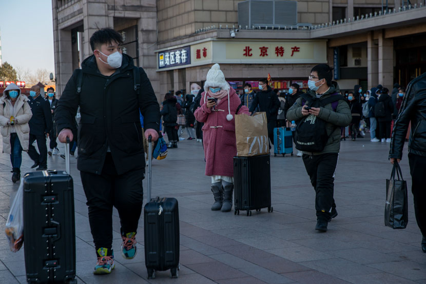 Tourists walk out of Beijing Railway Station in Beijing, Dec. 30, 2020. Wang Zicheng/IC