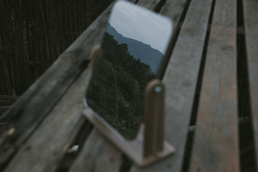 A view of the mountains reflected in a mirror at the commune in rural Fuzhou, Fujian province, Dec. 1, 2020. Shi Yangkun/Sixth Tone