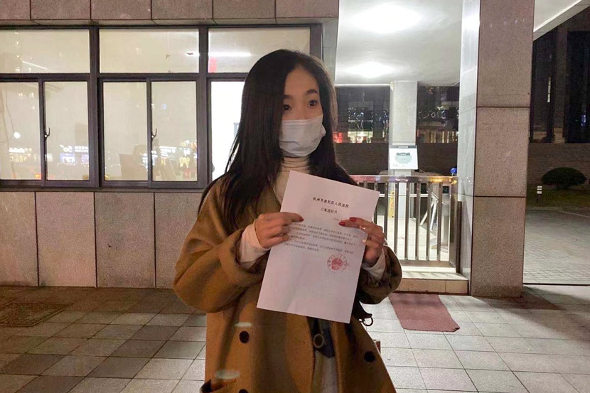 Wu Min holds the notice verifying her case was accepted outside the court in Hangzhou, Zhejiang province, December 2020. Courtesy of Wu Min