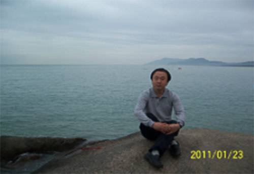 A dated photo of Tuo Jiguang, a journalism professor who killed himself on Oct. 18 following a decadelong resettlement dispute with Chengdu authorities. From Sichuan Normal University