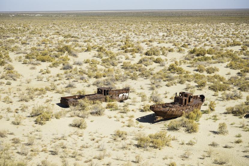 Abandoned fishing boats sit on the dried-up floor of the Aral Sea in Karakalpakstan, Uzbekistan, Oct. 10, 2017. Courtesy of Liu Zichao