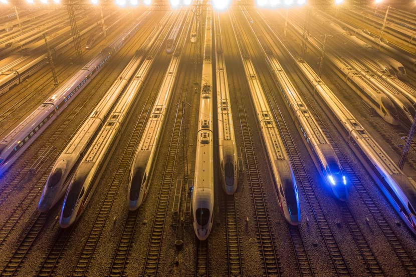 Bullet trains are idle the evening before the first day of the Spring Festival travel period at Guangzhou South Railway Station, Guangdong province, Jan. 28, 2021. People Visual