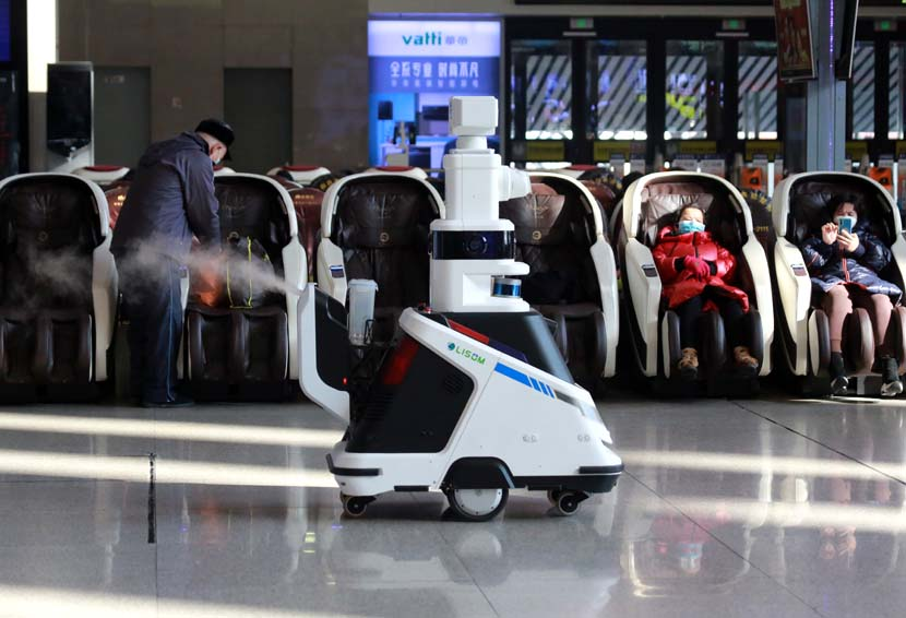 An air-sanitizing robot patrols the waiting halls of Shenyang Railway Station, Liaoning province, Jan. 28, 2021. People Visual