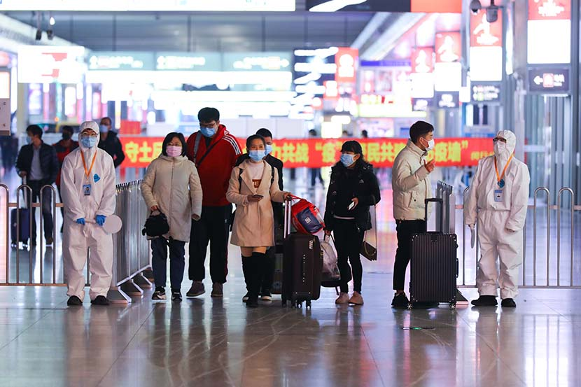 Passengers arrive at Hongqiao Railway Station in Shanghai, Jan. 28, 2021. People Visual