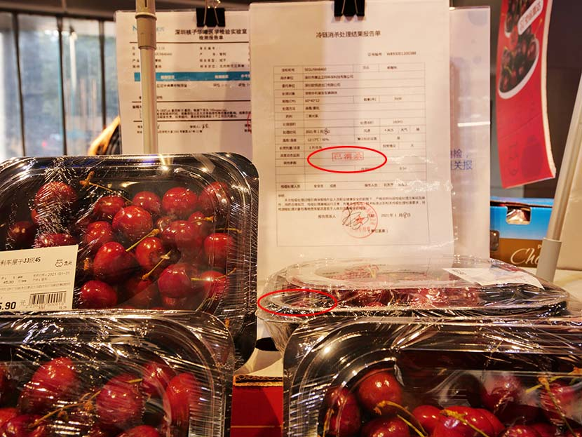 A sterilization report indicating that these cherries are safe to be sold at a supermarket in Guangzhou, Guangdong province, Feb. 1, 2021. People Visual