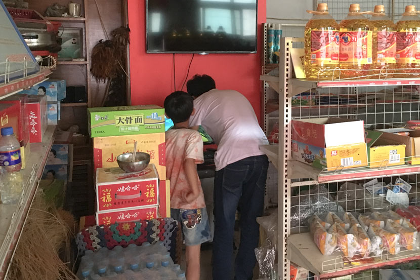 Villagers buy goods at an e-commerce store, 2016. Courtesy of Zhang Wenxiao
