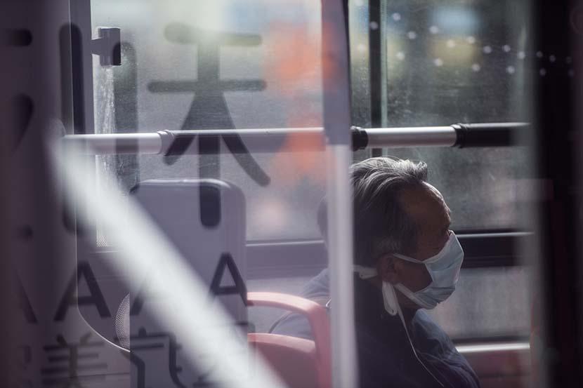 An elderly man on a public bus in Hangzhou, Zhejiang province, Feb. 8, 2020. People Visual