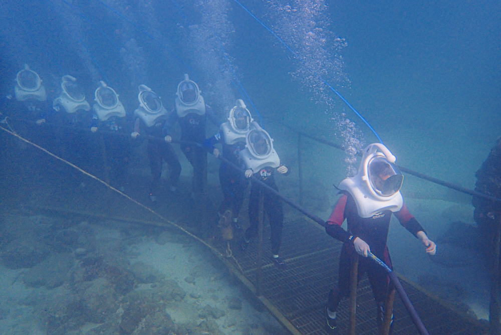 Tourists experience an underwater sea walk in Sanya, Hainan province, Feb. 15, 2021. People Visual