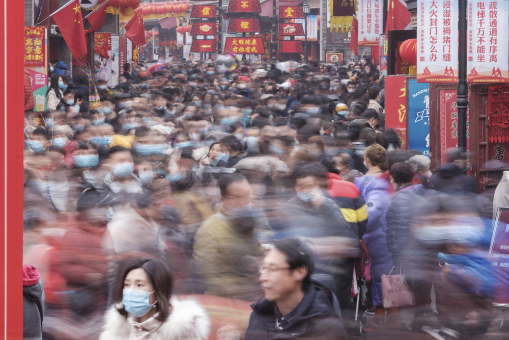 Visitors crowd the Ancient Culture Street in Tianjin, Feb. 13, 2021. People Visual