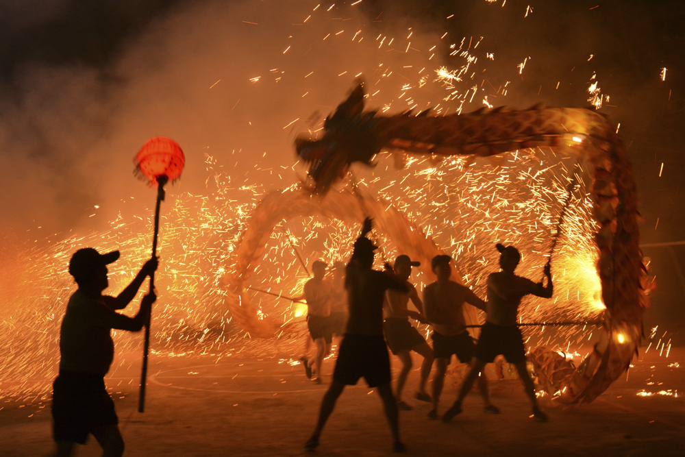 People perform a fire dragon show in rural Deyang, Sichuan province, Feb. 7, 2021. People Visual