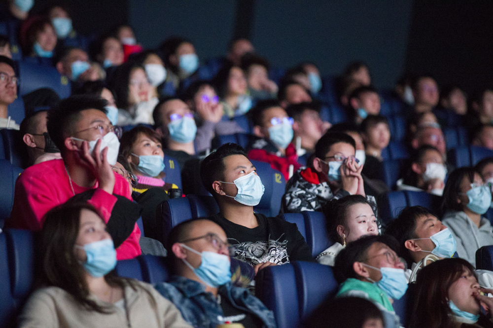 Cinemagoers watch a film in Taiyuan, Shanxi province, Feb. 12, 2021. China's box office for the 2021 Spring Festival reached over 7.5 billion yuan ($1.6 billion), smashing the holiday record. Zhang Yun/CNS/People Visual