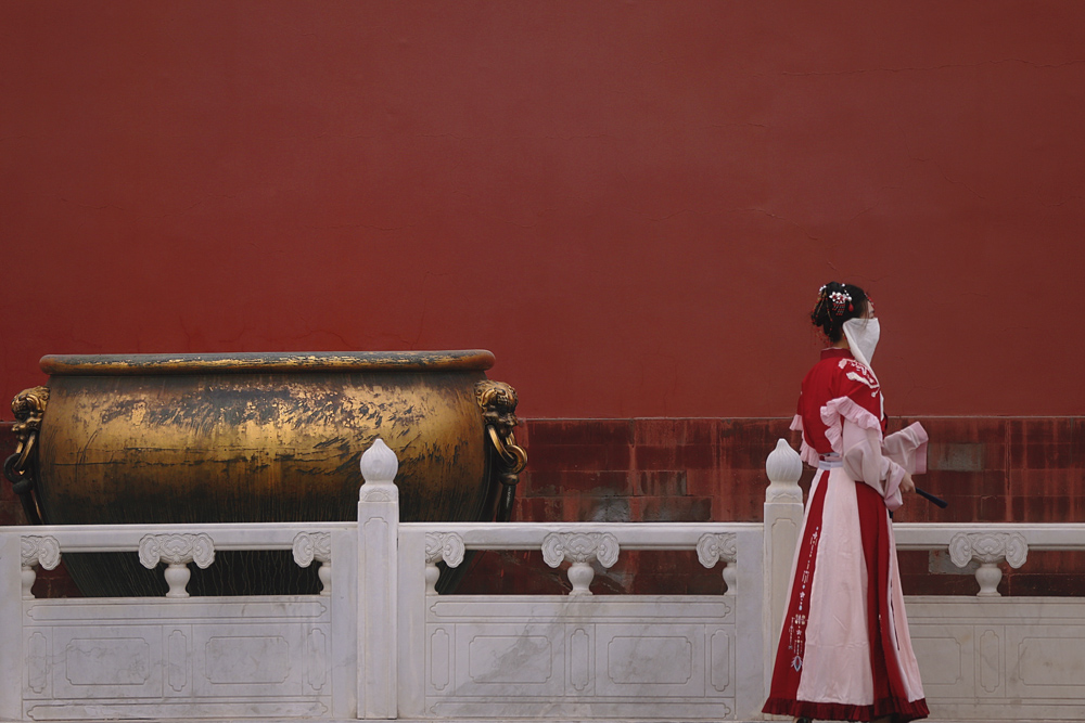 "A young woman in traditional Chinese ""hanfu"" clothing walks through the Palace Museum in Beijing, Feb. 12, 2021. People Visual"