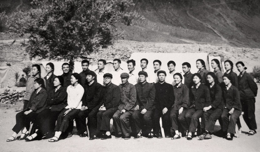 A staff photo from the hospital where Zhang (front row, first from right) worked in Pakistan, 1970s. Courtesy of Zhang Jingdu