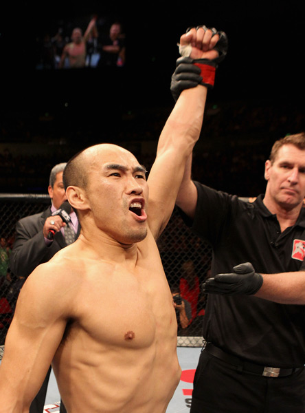 Zhang Tiequan celebrates after defeating Jason Reinhardt of the USA during their featherweight bout at UFC 127 in Sydney, Australia, Feb. 27, 2011. Josh Hedges/Zuffa LLC/People Visual