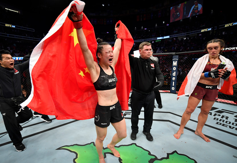 Zhang Weili celebrates following her split-decision victory over Joanna Jedrzejczyk of Poland in their UFC strawweight championship fight during the UFC 248 event in Las Vegas, USA, March 7, 2020. Jeff Bottari/Zuffa LLC/People Visual
