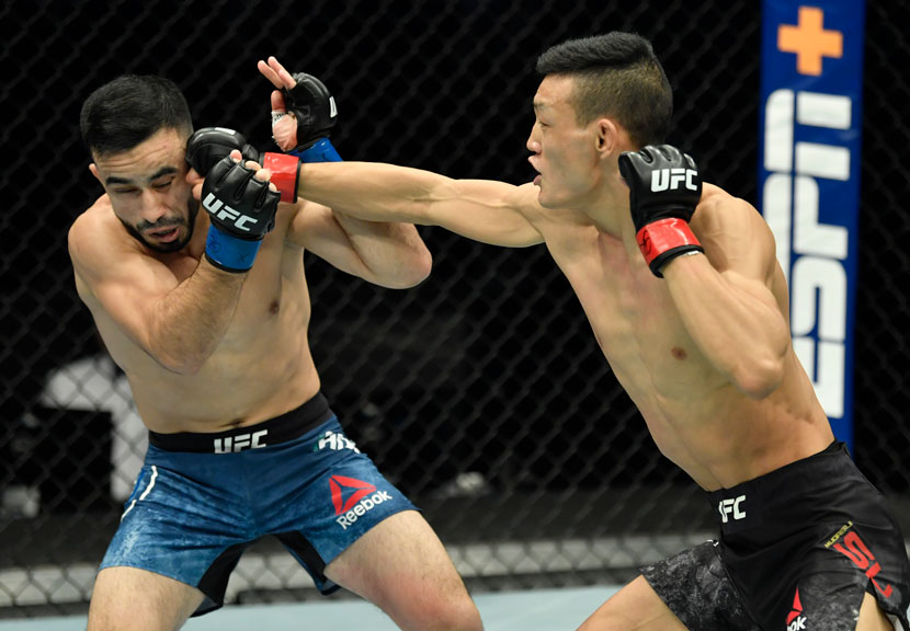 Su Mudaerji (right) punches Zarrukh Adashev of Uzbekistan during their flyweight bout at the UFC Fight Night event in Abu Dhabi, United Arab Emirates, Jan. 20, 2021. Jeff Bottari/Zuffa LLC