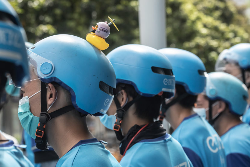 Delivery drivers during a morning staff meeting in Guangzhou, Guangdong province, June 2020. People Visual