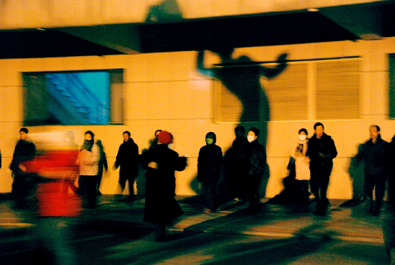 Local residents dance at the in front of a workers' cultural palace in Northeast China, 2009. Courtesy of Wang Hongzhe