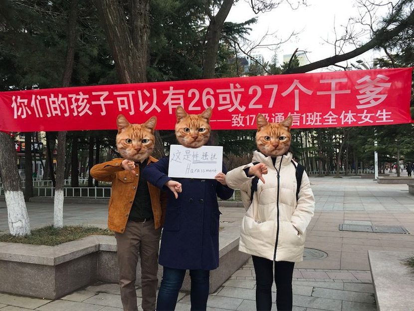 "Three students pose in front of a Girls' Day banner that reads, ""Your daughter has 26 or 27 godfathers (among her male classmates)."" Courtesy of Joanne"