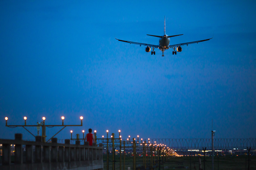 A plane prepares to land at Shanghai Hongqiao Airport, Aug. 18, 2017. People Visual