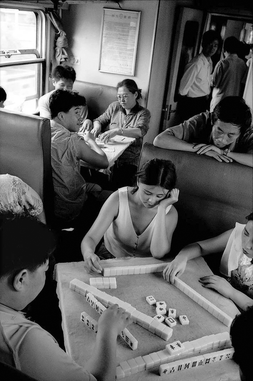 Passengers on a train from Beijing to Shenyang in northern China, 1994. Courtesy of Chinese Photography