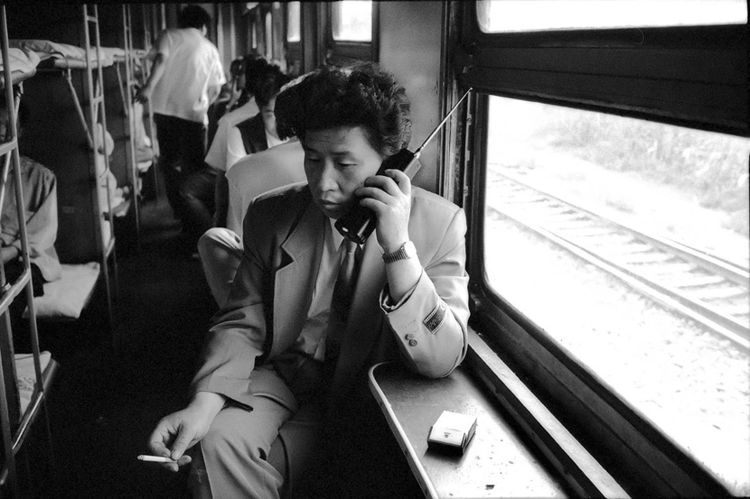 A passenger on a train from Shenyang to Dalian in northern China, 1994. Courtesy of Chinese Photography