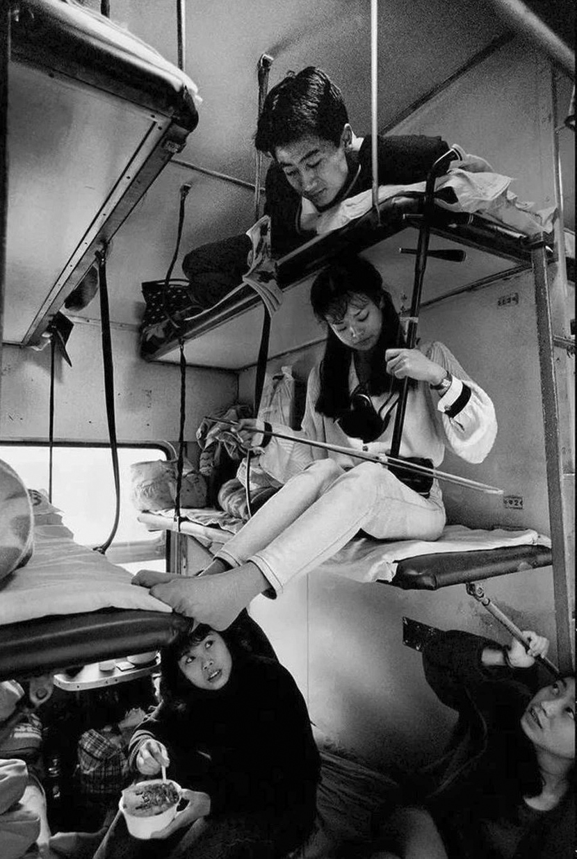 Passengers on a train from Guangzhou to Chengdu in southern China, 1996.  Courtesy of Chinese Photography