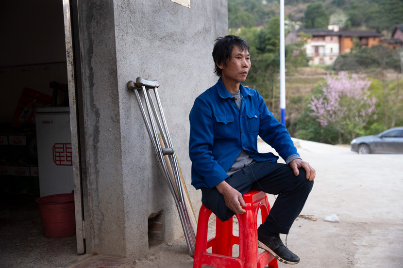 Fan Jiafa sits outside his home in Yanhui Village, Ji'an, Jiangxi province, Feb. 22, 2021. IC