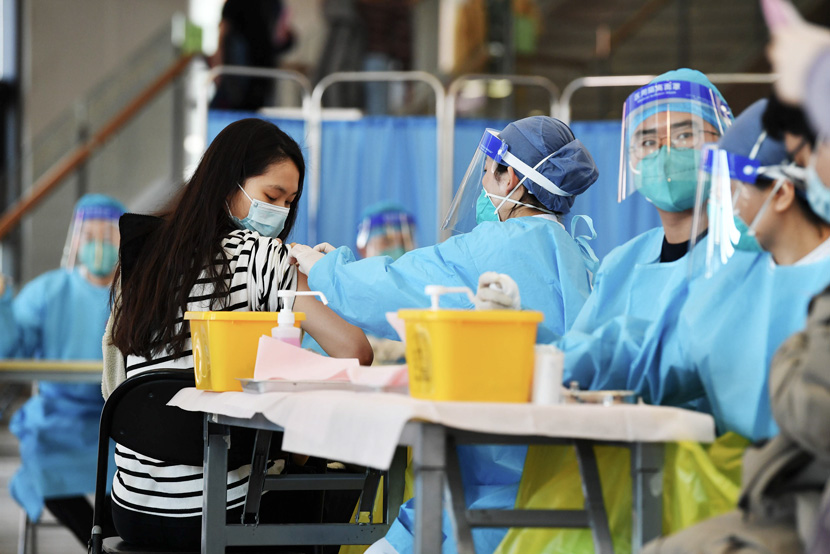 A student is injected with a COVID-19 vaccine at Tsinghua University in Beijing, March 1, 2021. Yuan Yi/Beijing Youth Daily/People Visual
