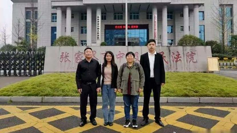 The Zhang sisters pose for a photo with their lawyers outside the Zhangjiajie Intermediate People's Court in Hunan province, Nov. 18, 2020. From The Paper