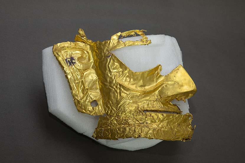 A fragment of a gold mask recently found at the Sanxingdui Ruins, Guanghan, Sichuan province, March 17, 2021. Xinhua