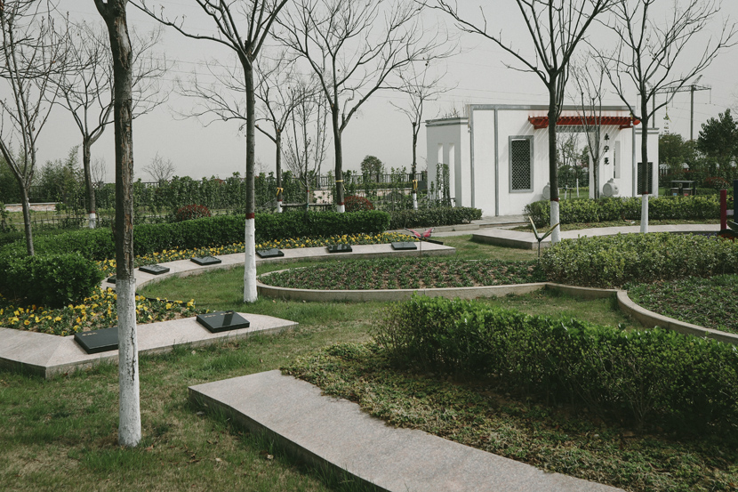"""A view of a designated area at Luoyang Crane Memorial Cemetery for scattering the ashes of the nameless dead, in Luoyang, Henan province, March 2021. The area in the bottom right is assigned to the nameless dead, as part of """"natural burial,"""" a method the Chinese government is trying to promote. Yuan Ye/Sixth Tone"""