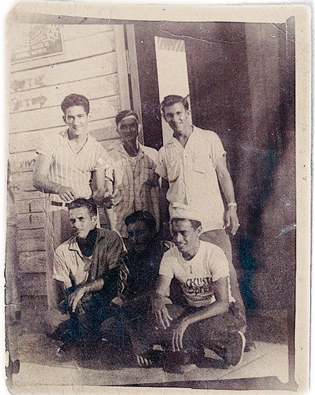 Huang Baoshi (center, back) and some locals, including his adopted son in Cuba, 1958. Courtesy of Huang Zhuocai