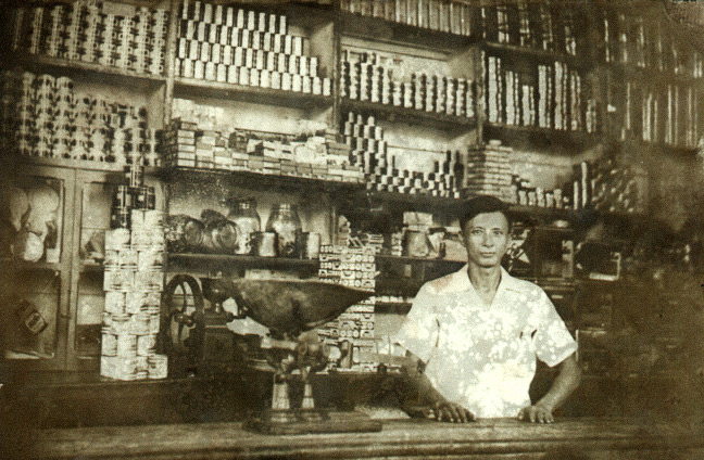 Huang Baoshi in his general store, in 1936/1937. Courtesy of Huang Zhuocai