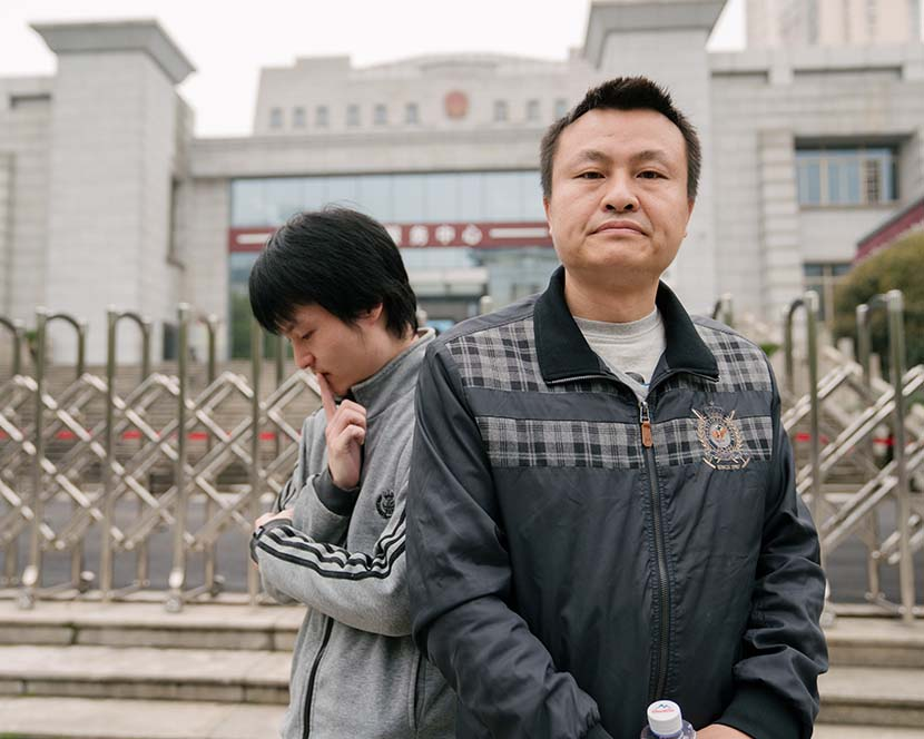 LGBT rights activist Sun Wenlin (left) and his partner Hu Mingliang outside the Changsha Furong District People's Court in Changsha, Hunan province, March 16, 2021. Wu Huiyuan/Sixth Tone
