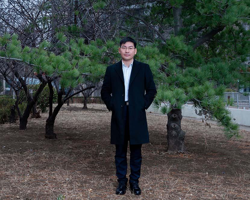 Wang Fei poses for a photo in Beijing, March 2, 2021. Shi Yangkun/Sixth Tone