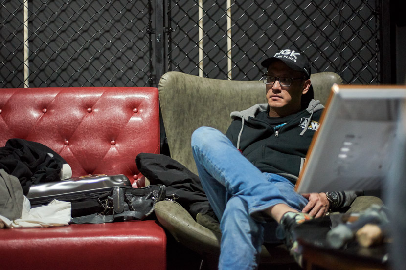 OWE's vice president, Michael Nee, rests backstage during a gig at Punch Cage, in Shanghai, March 19, 2021. Courtesy of Luiz Vagostelo