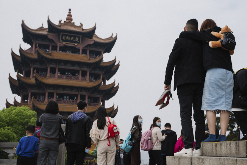 Tourists visit the Yellow Crane Tower, a famous sightseeing destination in Wuhan, Hubei province, April 4, 2021. Shi Yangkun/Sixth Tone