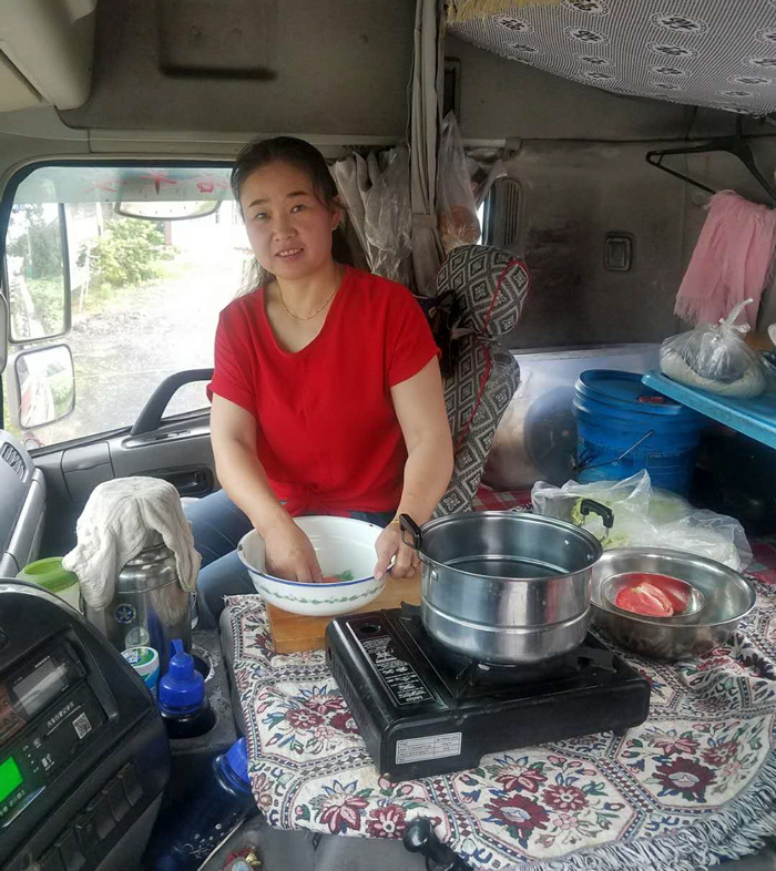 Miao Huiling cooks a meal in the truck. Courtesy of Transfar Harbour