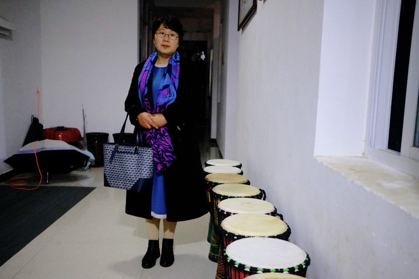 Yu Hua poses for a photo in Jinzhai County, Anhui province, March 2021. She commutes between the school and her home every day to supervise activities at Home of the Stars. Wu Huiyuan/Sixth Tone