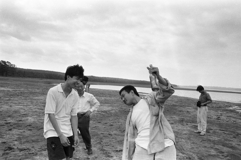 1996: Someone took this photo with my camera while on a trip to Xinlicheng Reservoir in the suburbs of Changchun . I had just finished a bottle of beer and was dancing without a care in the world.