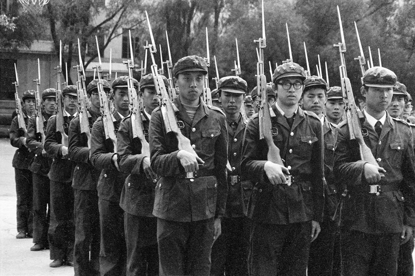 1993: Freshmen practice the rifle march. From that year on, target shooting was no longer part of military training; and in 1994, all drills involving rifles were cancelled.