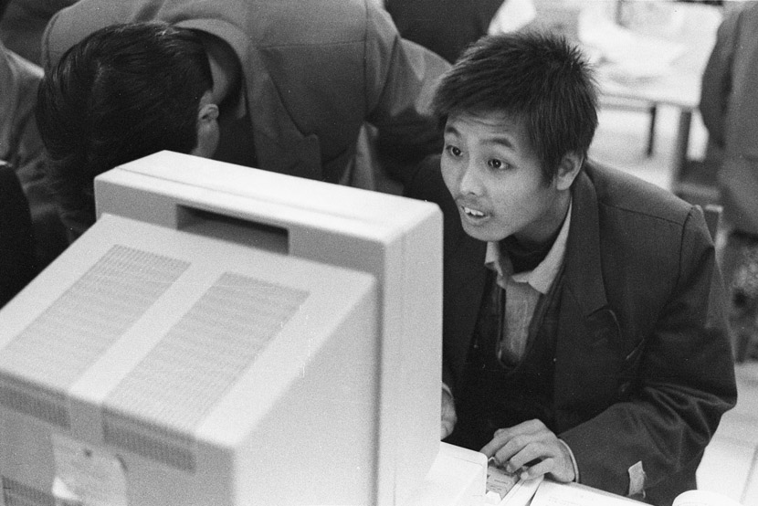 1994: A freshman using a computer for the first time ever. Computers were probably the most attractive thing on campus for students at the time. Few could afford one in the early 1990s.