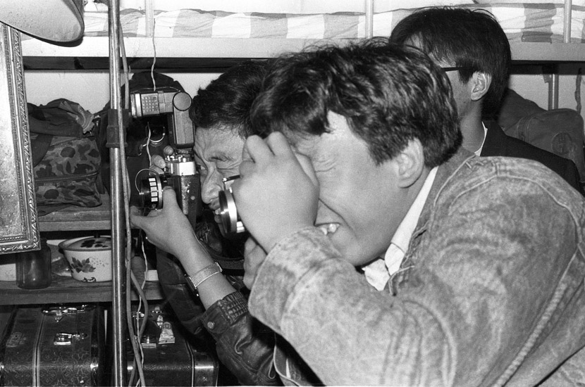 1994: Guan Jue and Zhang Tao taking photos in the dormitory. The Phoenix 205  was the first camera for many photography students. It was capable of producing clear images and cost about 200 yuan in the early 1990s.